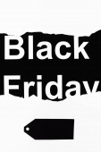 Black friday lettering and price tag on white and black background