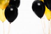 Černožluté slavnostní balónky izolované na bílém