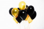 Festive black and golden balloons isolated on white