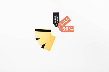 Top view of credit cards and price tags with black friday and sale lettering on white background stock vector