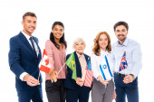 Photo Smiling multiethnic businesspeople holding flags of countries isolated on white