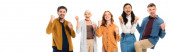 Excited multiethnic friends showing like and yeah gestures isolated on white, banner