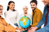Smiling multicultural people holding globe isolated on white