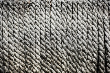 full frame of arranged grey ropes background