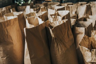 Rows of paper bags with coffee for selling