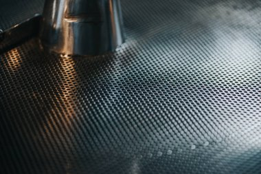 Metal grid texture of coffee roasting machine