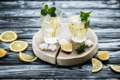 high angle view of cold fresh summer cocktail with mint and ice cubes in glasses