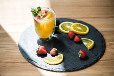 close-up view of delicious refreshing summer cocktail in glass on slate board