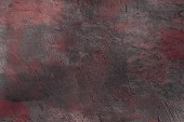 sötét szürke és vörös durva kiadványról fali textúrázott háttérre