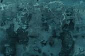 full-frame kilátás-ból háttér sötét szürke repedt fal texturált