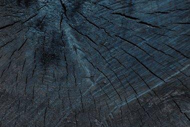 close-up view of dark grey cracked wooden textured background