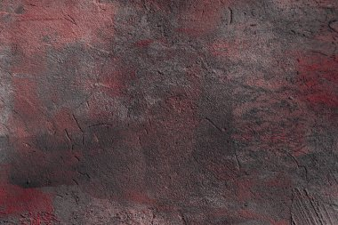 close-up view of dark grey and red rough wall textured background