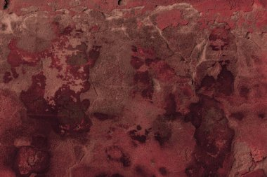 full frame view of dark red cracked wall textured background
