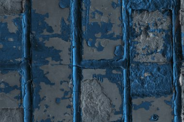 close-up view of old weathered blue and grey brick wall