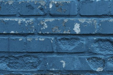 close-up view of old weathered blue brick wall background