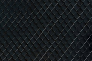 metal fence on black background, full frame view