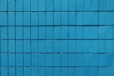 blue wall with old bricks, full frame background