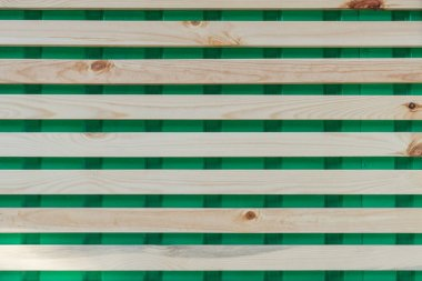 horizontal wooden planks on green, full frame background