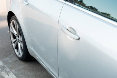 detail of parked shiny white car, transport background