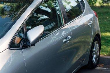 detail of parked shiny grey car, transport background