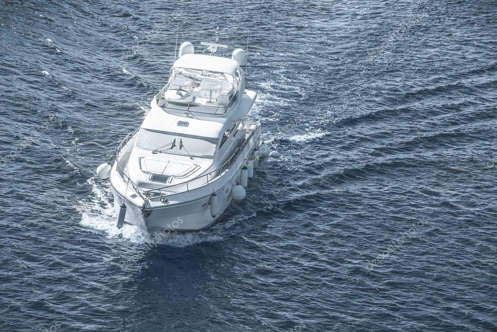 white ship sailing on blue sea