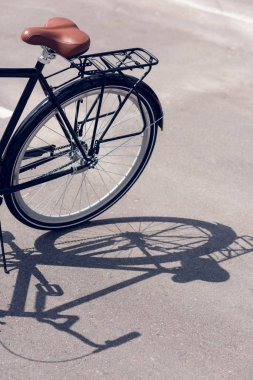 close up view of retro bicycle parked on street
