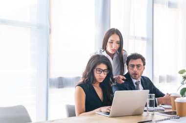 portrait of multiracial businessman and businesswomen working on business project together in office