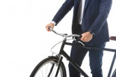cropped image of businessman standing with bicycle isolated on white background