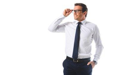 happy businessman adjusting eyeglasses isolated on white background