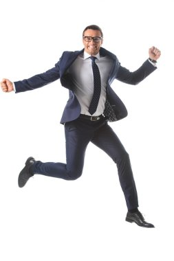 happy businessman in eyeglasses jumping and gesturing by hands isolated on white background