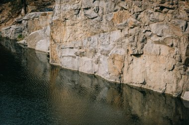 scenic view of rocky cliff reflecting in river surface