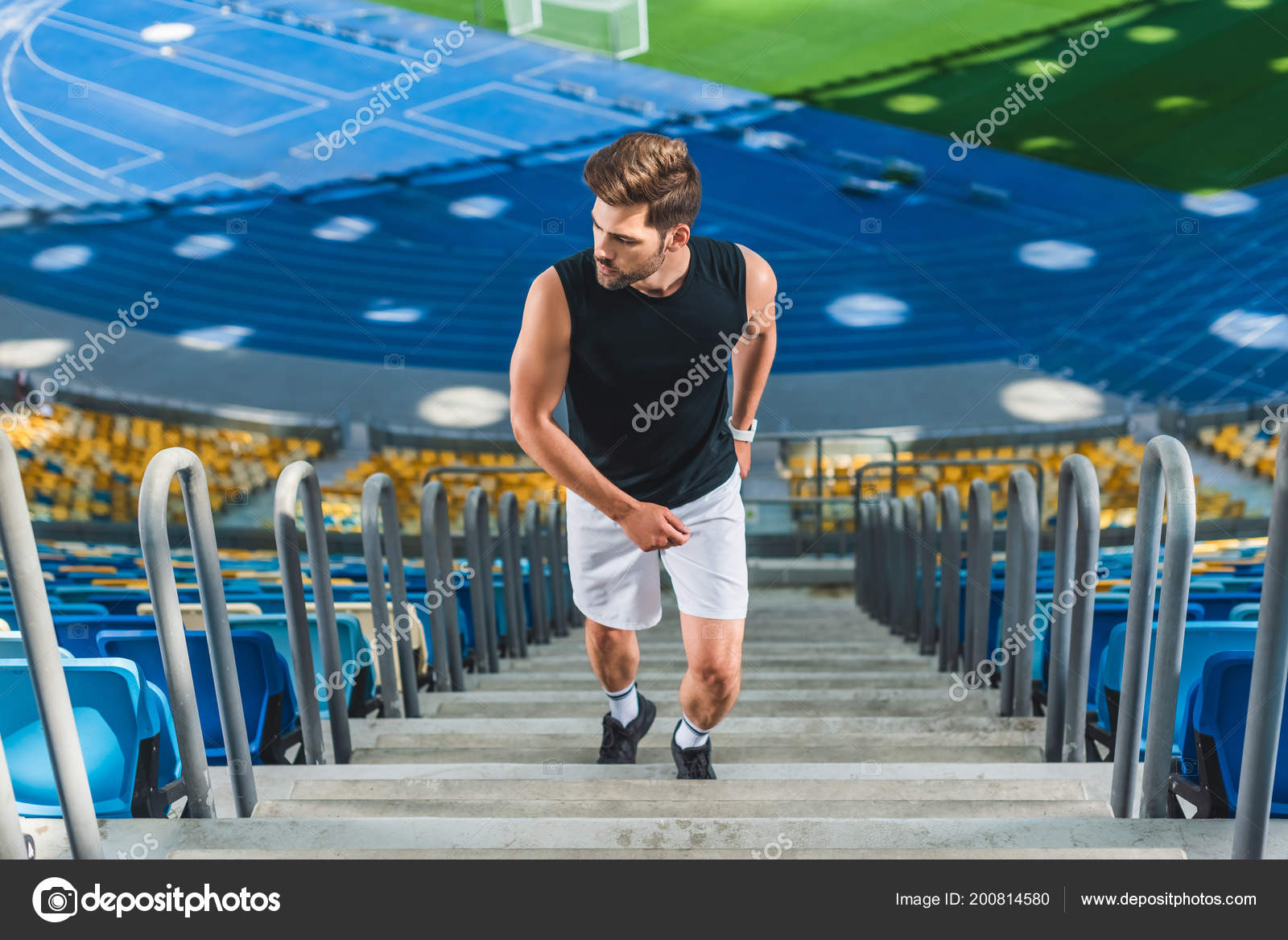 c35815cd5b64 High Angle View Sportive Young Man Jogging Upstairs Sports Stadium — Stock  Photo