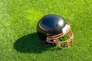 high angle view of american football helmet lying on grass