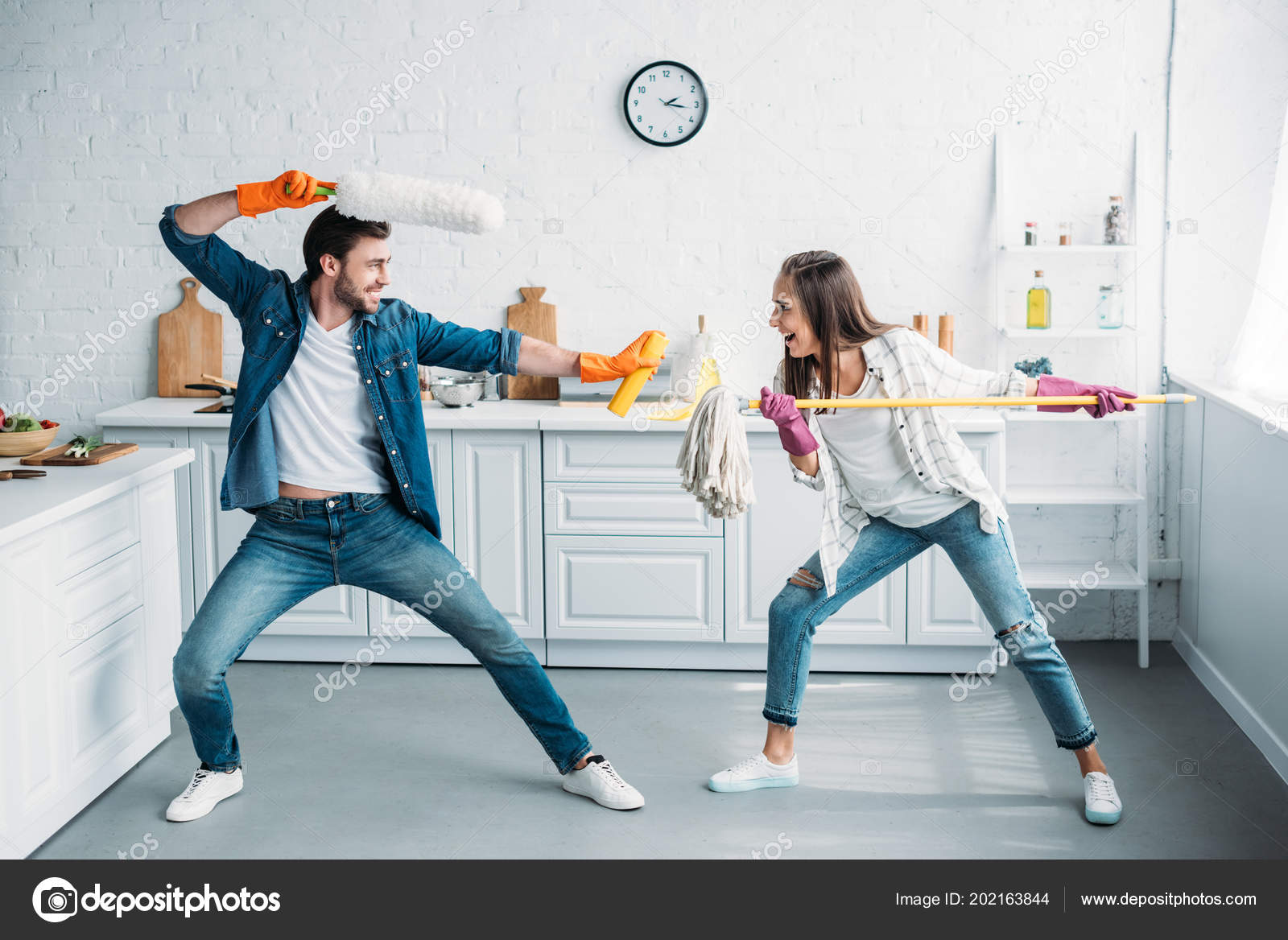 Couple Having Fun Pretending Fight Cleaning Tools Kitchen — Stock ...