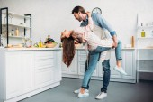 Fotografie couple dancing tango together in kitchen