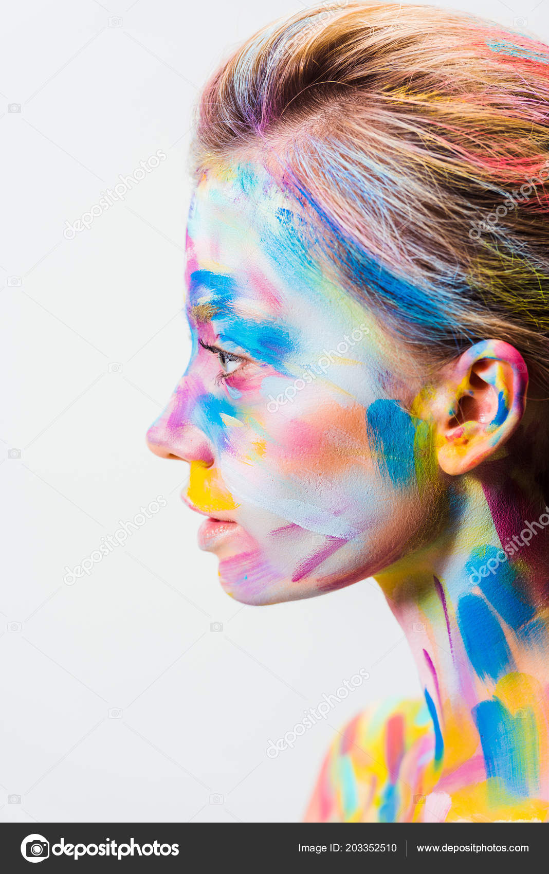 Side view attractive girl colorful bright body art isolated white stock photo