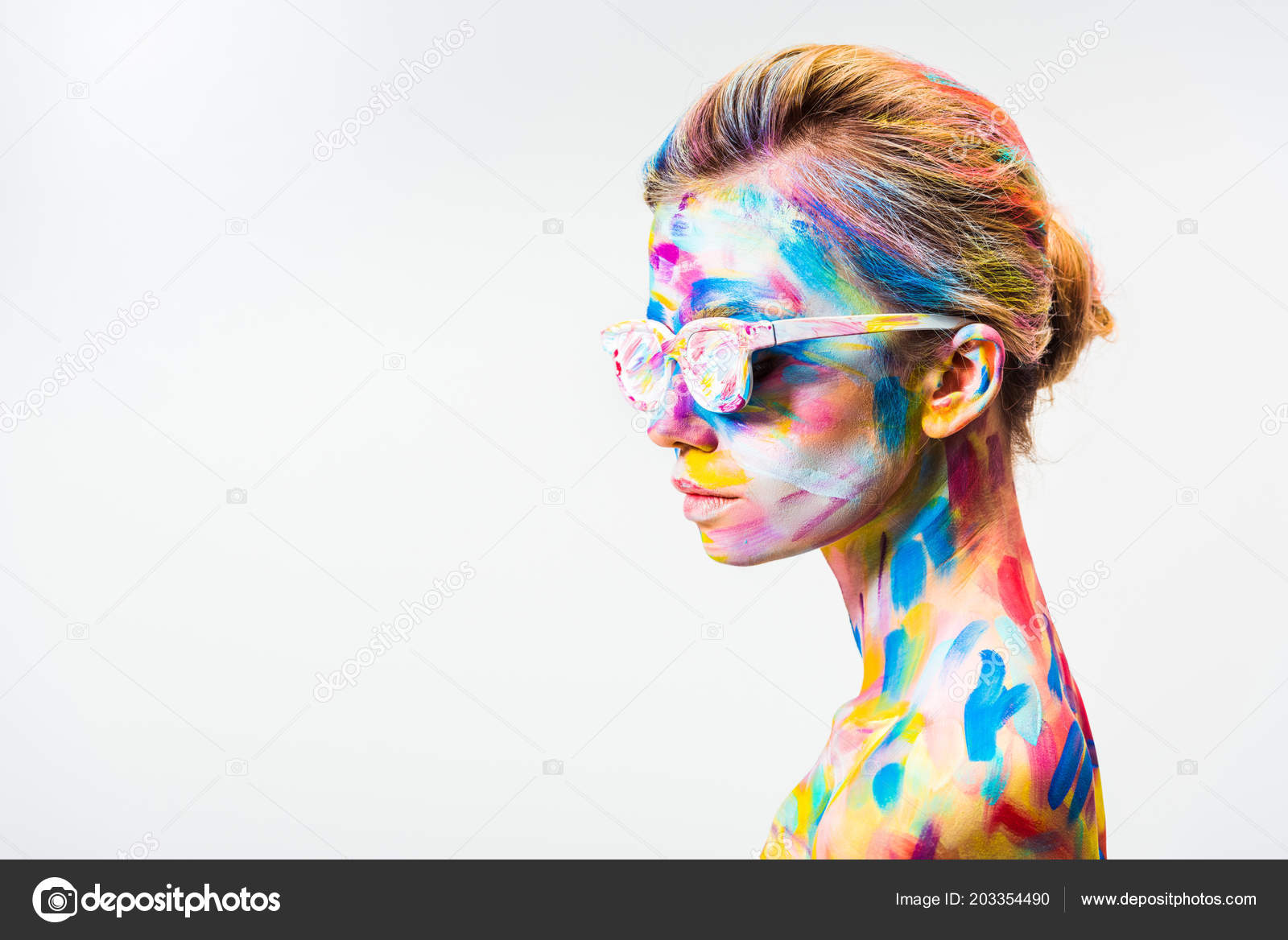 Side view attractive girl colorful bright body art sunglasses isolated photo