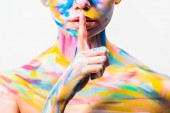 Fotografie cropped image of girl with colorful bright body art showing silence gesture isolated on white