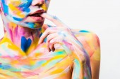 Photo cropped image of girl with colorful bright body art biting finger isolated on white