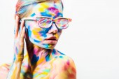attractive girl with colorful bright body art and sunglasses looking away isolated on white