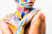 Fotografie cropped image of girl with colorful bright body art touching shoulders isolated on white