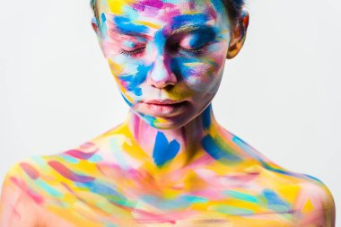 attractive girl with colorful bright body art and closed eyes isolated on white