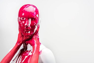 cropped image of girl in red paint touching mannequin neck with hands isolated on white