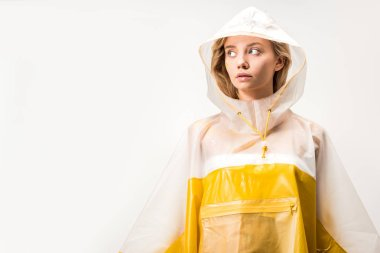 beautiful woman in yellow and white raincoat looking away isolated on white