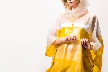 cropped image of woman in raincoat touching zip isolated on white