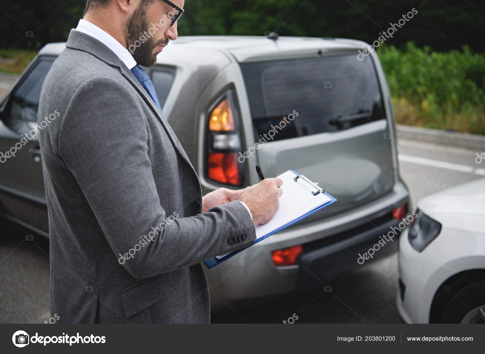 Car Insurance After Accident >> Side View Man Writing Something Car Insurance Car Accident