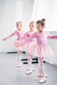adorable little ballerinas practicing together in ballet studio