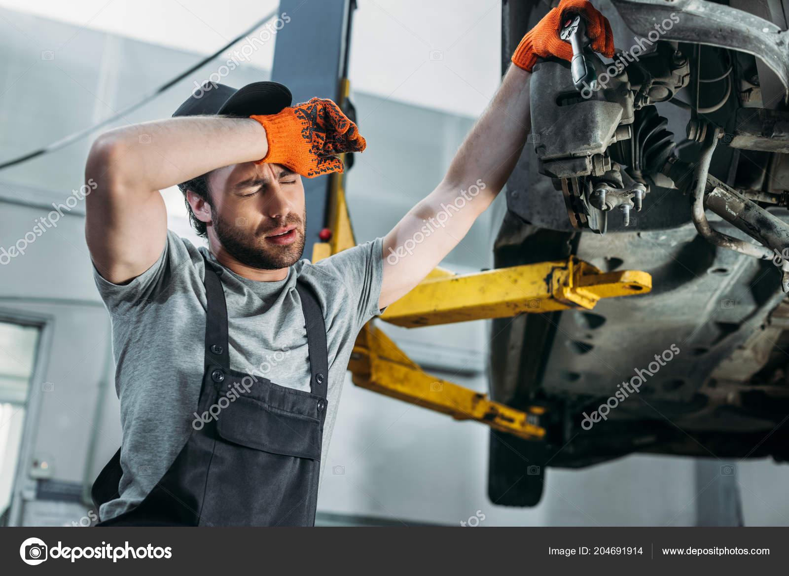 Professional Tired Mechanic Uniform Repairing Car — Stock Photo