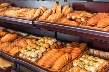 Selective focus of freshly baked various bread in pastry department of hypermarket stock vector