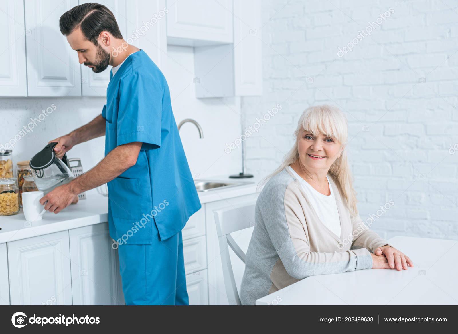 Happy Senior Woman Sitting Smiling Camera While Caregiver Pouring ...